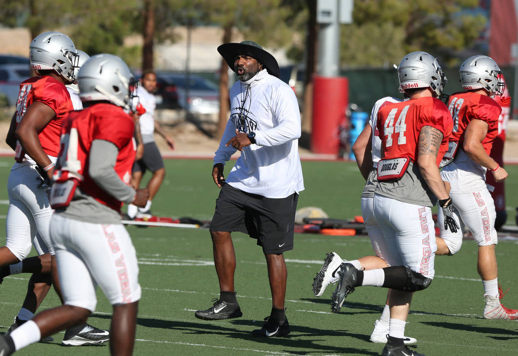 Travis Burkett, UNLV director of football strength and conditioning, instructs his players during team practice on Tuesday, Aug. 21, 2018, in Las Vegas. (Bizuayehu Tesfaye/Las Vegas Review-Journal ...