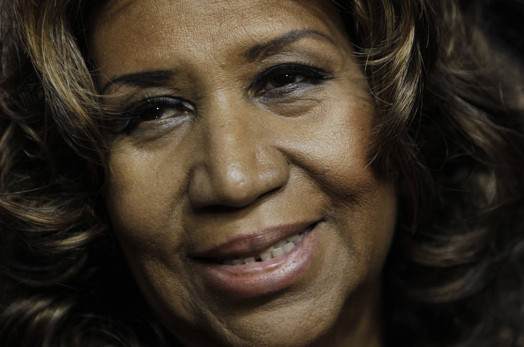 FILE - In this Feb. 11, 2011 file photo, Aretha Franklin smiles after the Detroit Pistons-Miami Heat NBA basketball game in Auburn Hills, Mich. Franklin died Thursday, Aug. 16, 2018 at her home ...