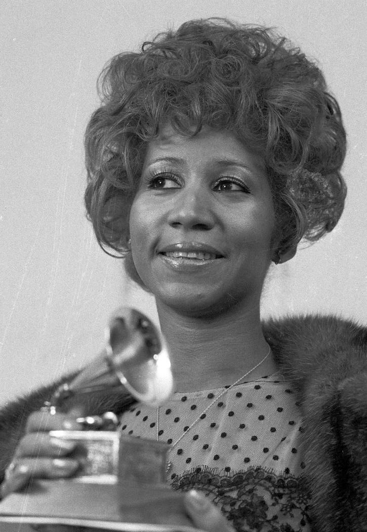 "FILE - In this March 13, 1972 file photo, Aretha Franklin holds her Grammy Award for Best Rhythm and Blue performance of the song ""Bridge Over Troubled Waters,"" in New York. Franklin d ..."