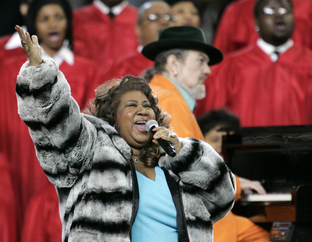 FILE - In this Feb. 5, 2006 file photo, Aretha Franklin and Dr. John, background on piano, perform the national anthem before the Super Bowl XL football game in Detroit. Franklin died Thursday, A ...