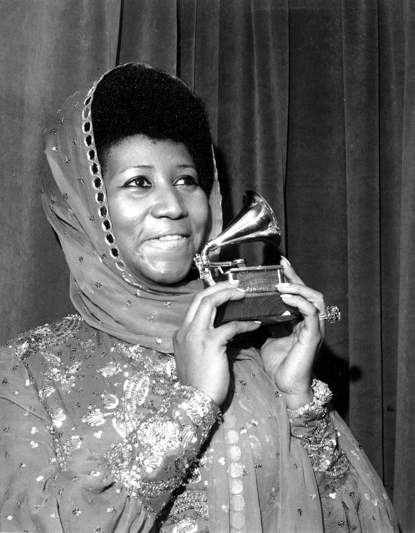"Singer Aretha Franklin poses with her Grammy Award for for best female R&B vocal performance for ""Ain't Nothing Like the Real Thing"" at the 17th Annual Grammy Award presentation in New York, March ..."