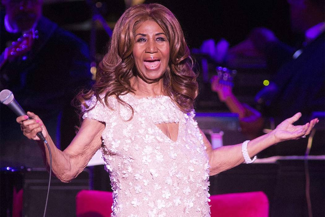 In this Aug. 26, 2017, file photo, Aretha Franklin performs in concert at The Mann Center for the Performing Arts in Philadelphia. During a performance on Monday, Aug. 13, 2018, Beyonce dedicated ...