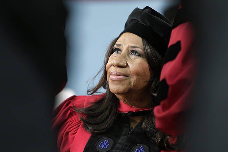 Aretha Franklin looks up while seated on stage during Harvard University commencement ceremonies, in Cambridge, Mass. (AP/Steven Senne)