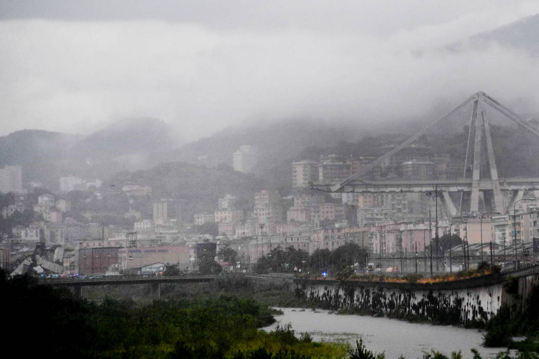 A view of the collapsed Morandi highway bridge in Genoa, Tuesday, Aug. 14, 2018. Italian authorities say that about 10 vehicles were involved when the raised highway collapsed during a sudden and ...