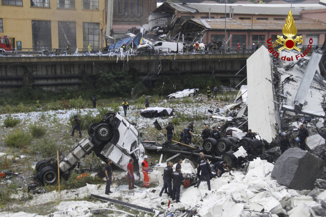 This photo released by the Italian firefighters, cars are seen among the rubble of the collapsed Morandi highway bridge in Genoa, northern Italy, Tuesday, Aug. 14, 2018. A bridge on a main highway ...
