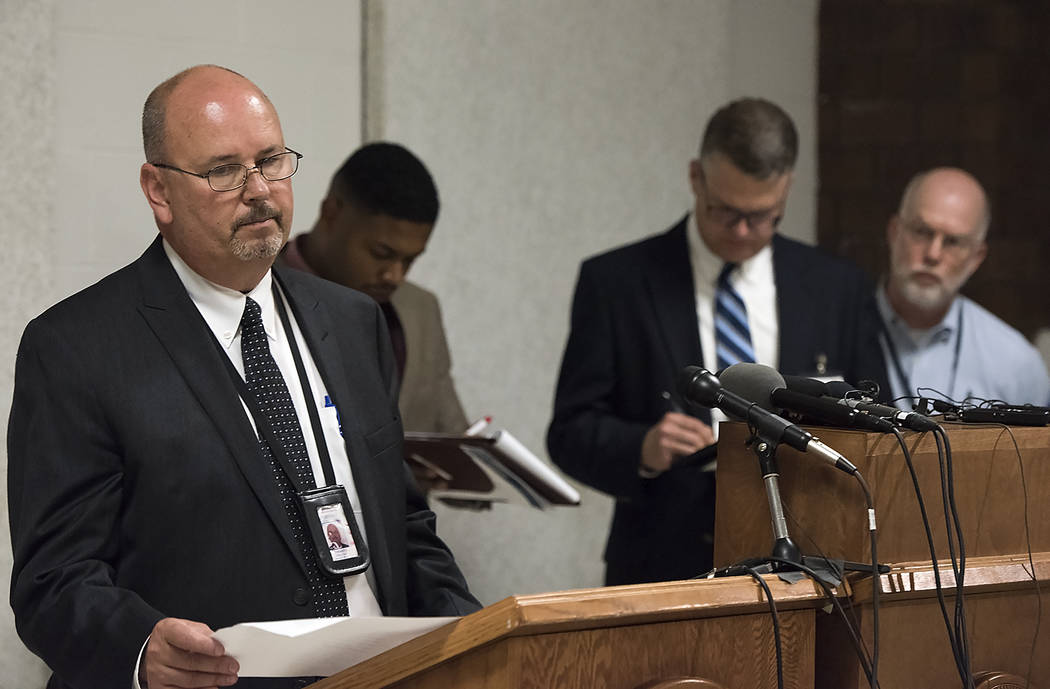 Scott Frakes, left, Director of Nebraska Department of Corrections, delivers a statement after the execution of Carey Dean Moore on Tuesday, Aug. 14, 2018. at the Nebraska State Penitentiary in Li ...