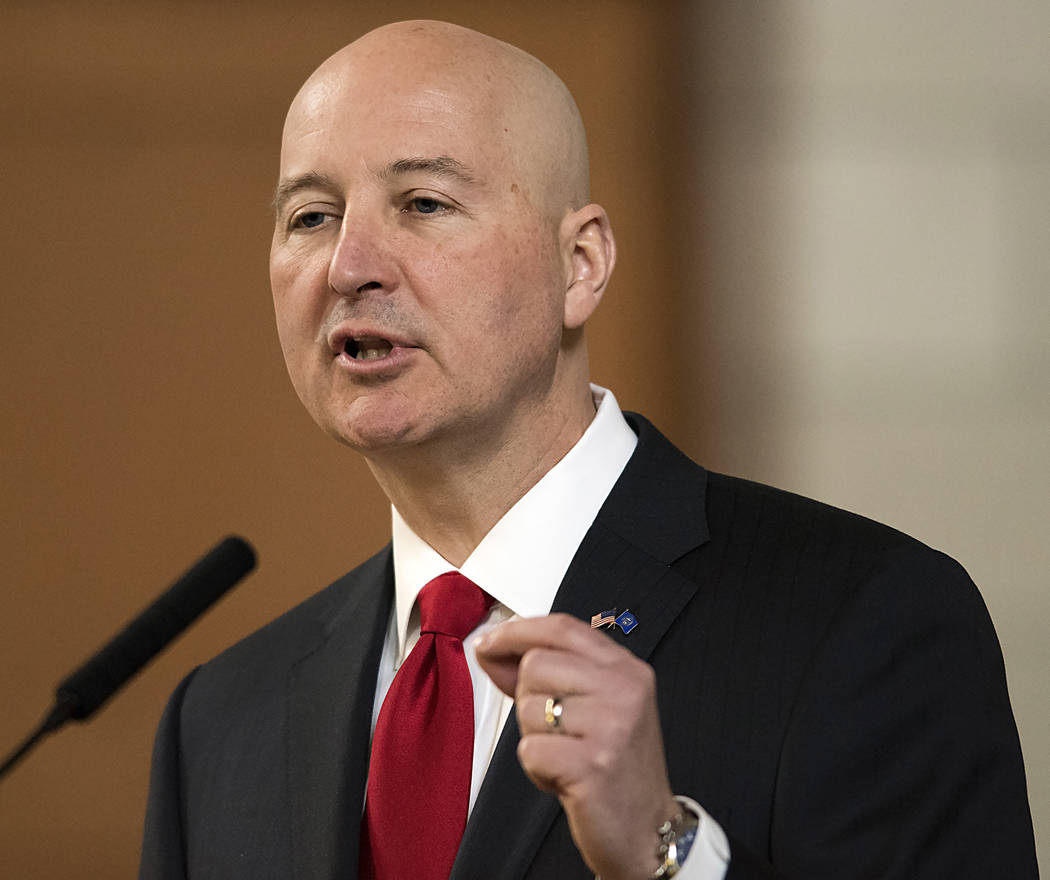 Nebraska Gov. Pete Ricketts speaks at the legislature, in Lincoln, Nebraska, April 18, 2018. Three years after Nebraska lawmakers voted to abolish capital punishment, the state carried out its fir ...