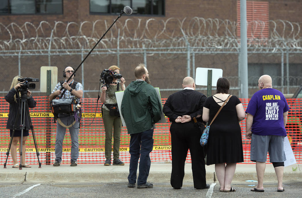 Protestors are photographed outside the Nebraska State Penitentiary in the public area, Tuesday, Aug. 14, 2018 in Lincoln, Nebraska. Nebraska carried out its first execution in more than two deca ...