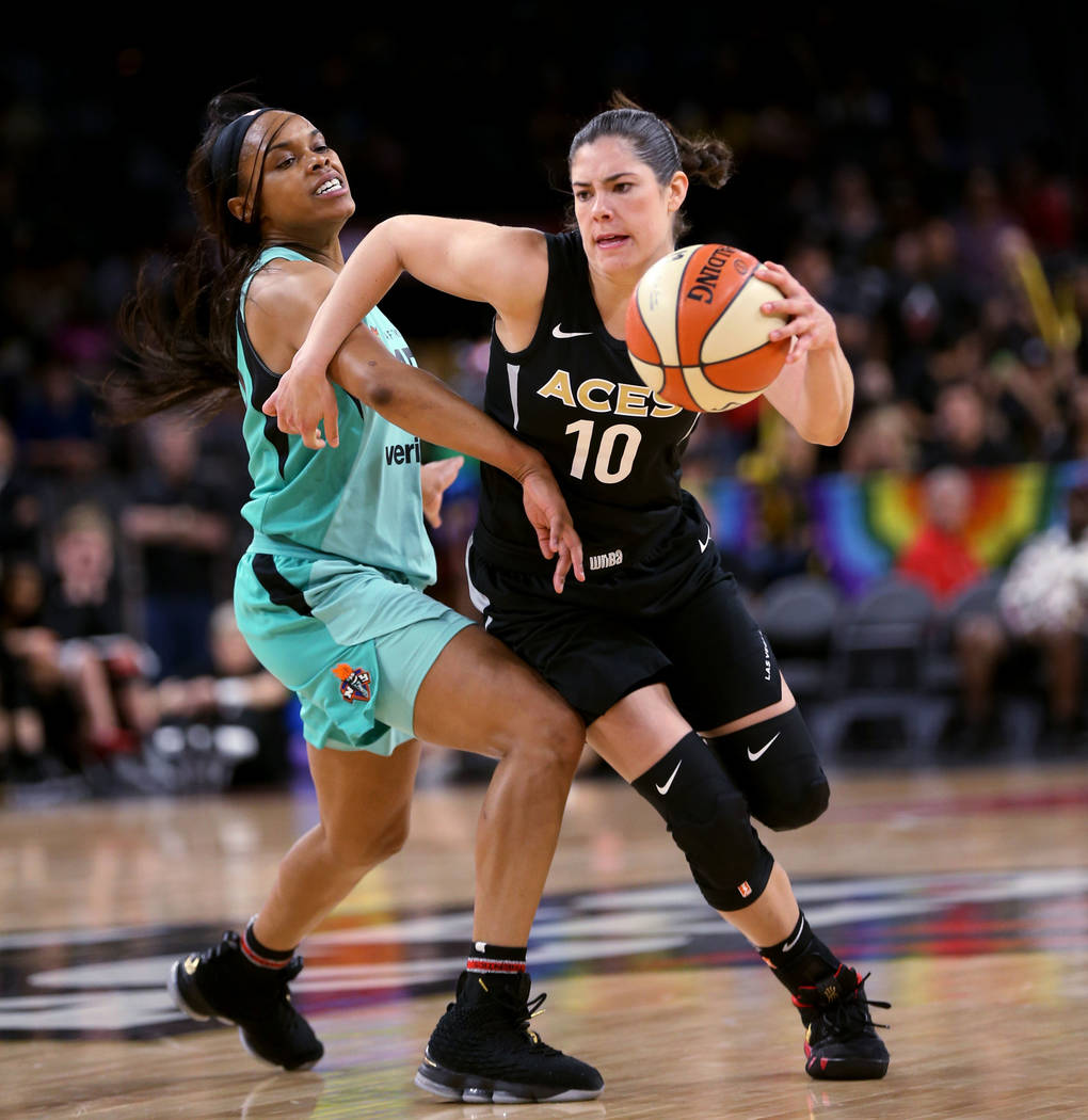 Las Vegas Aces guard Kelsey Plum (10) drives past New York Liberty guard Brittany Boyd (15) in the second half of a WNBA basketball game at the Mandalay Bay Events Center in Las Vegas on Friday, J ...