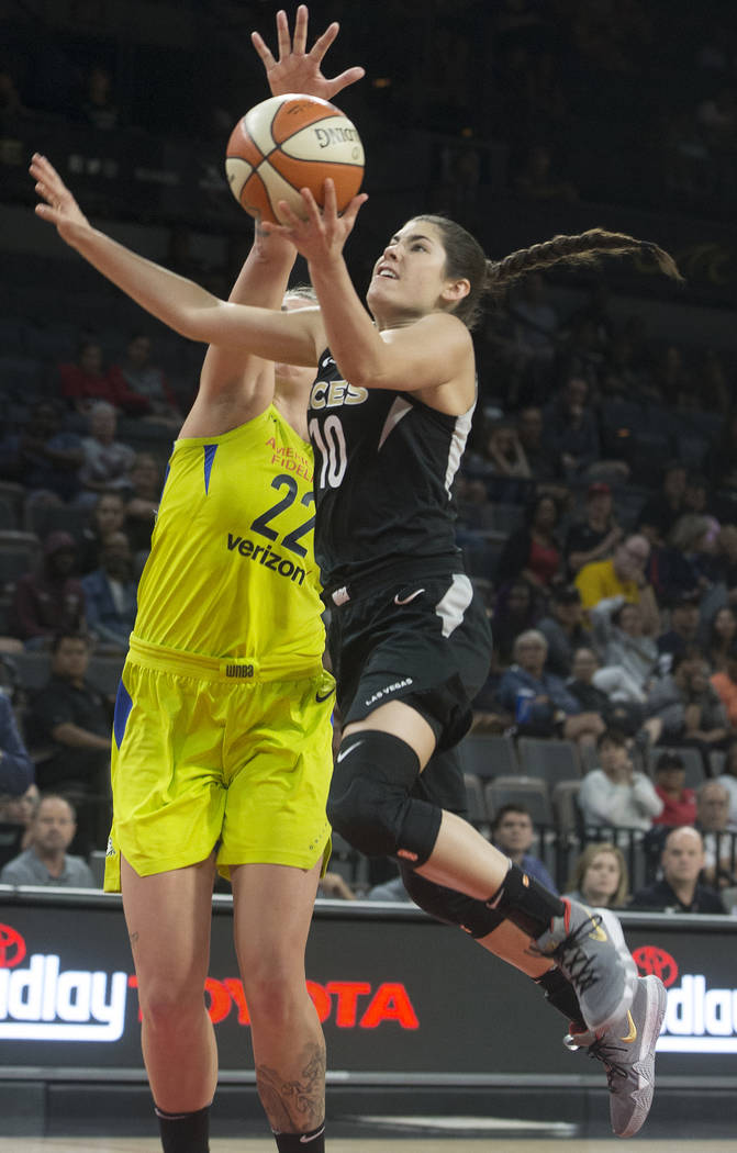 Aces guard Kelsey Plum (10) drives past Dallas Wings center Cayla George (22) in the 3rd quarter on Wednesday, June 27, 2018, at the Mandalay Bay Events Center, in Las Vegas. Benjamin Hager Las V ...