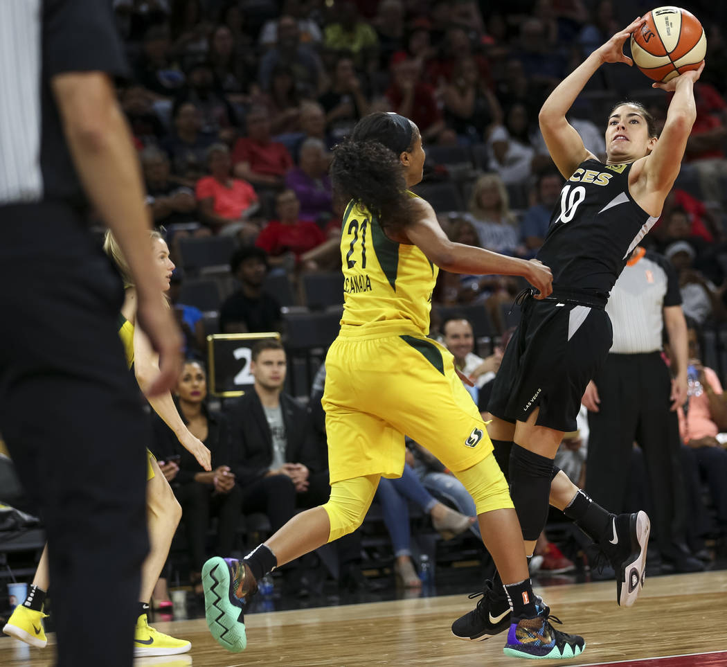 Las Vegas Aces guard Kelsey Plum (10) shoots over Seattle Storm guard Jordin Canada (21) in the second half of a WNBA basketball game at the Mandalay Bay Events Center in Las Vegas on Sunday, May ...