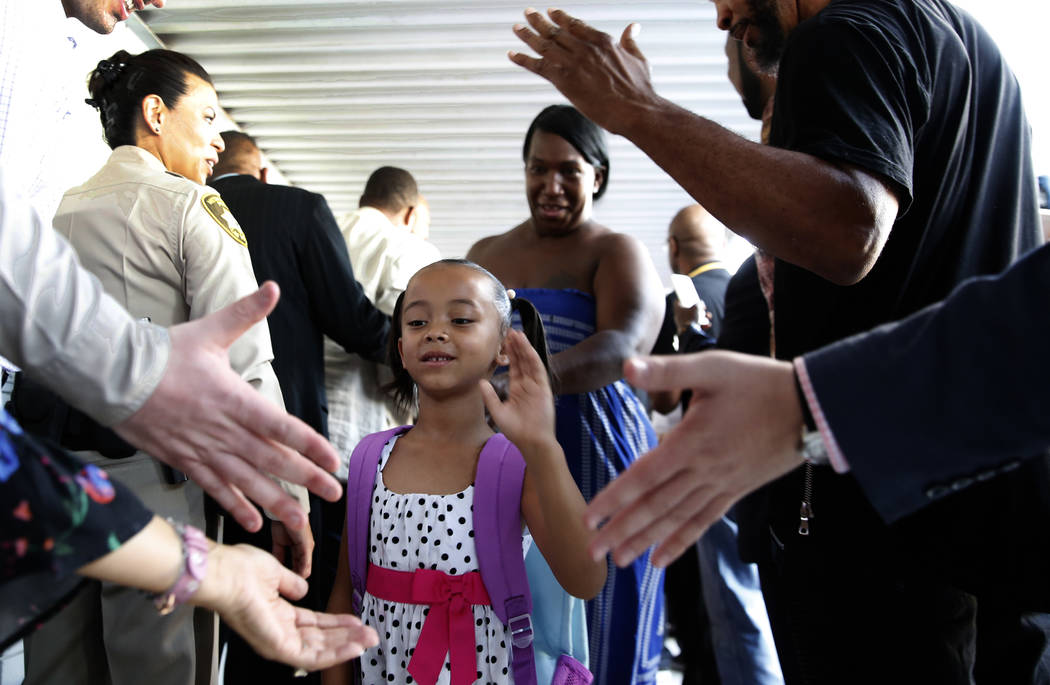 Matt Kelly Elementary School student Tiaryana Foster, 5, welcomed by community and business leaders with an inspirational welcome and red carpet as she arrives on her first day of school on Monday ...