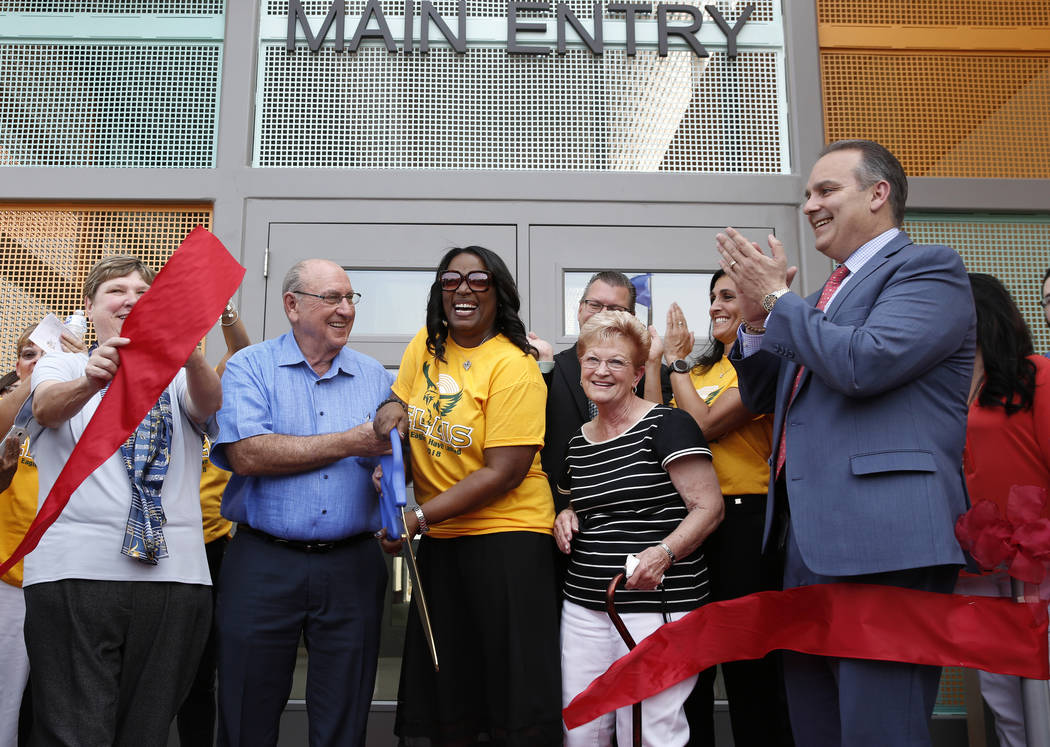 Deanna Wright, CCSD Board president, left, Robert Ellis, second left, and his wife Sandra, second right, philanthropic partners of the Clark County School District, Principal Dr. Shaun Cochran-Hal ...