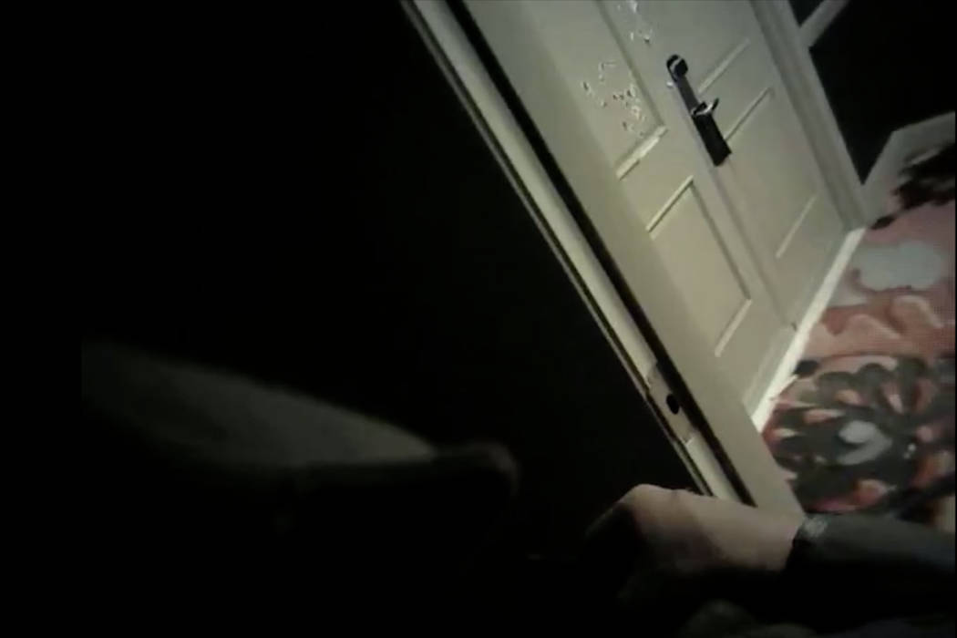 This screen grab taken from a video released on Wednesday, Aug. 15, 2018, by Las Vegas police shows bullet holes on the door of Stephen Paddock's room at Mandalay Bay. Metro released its 15th batc ...