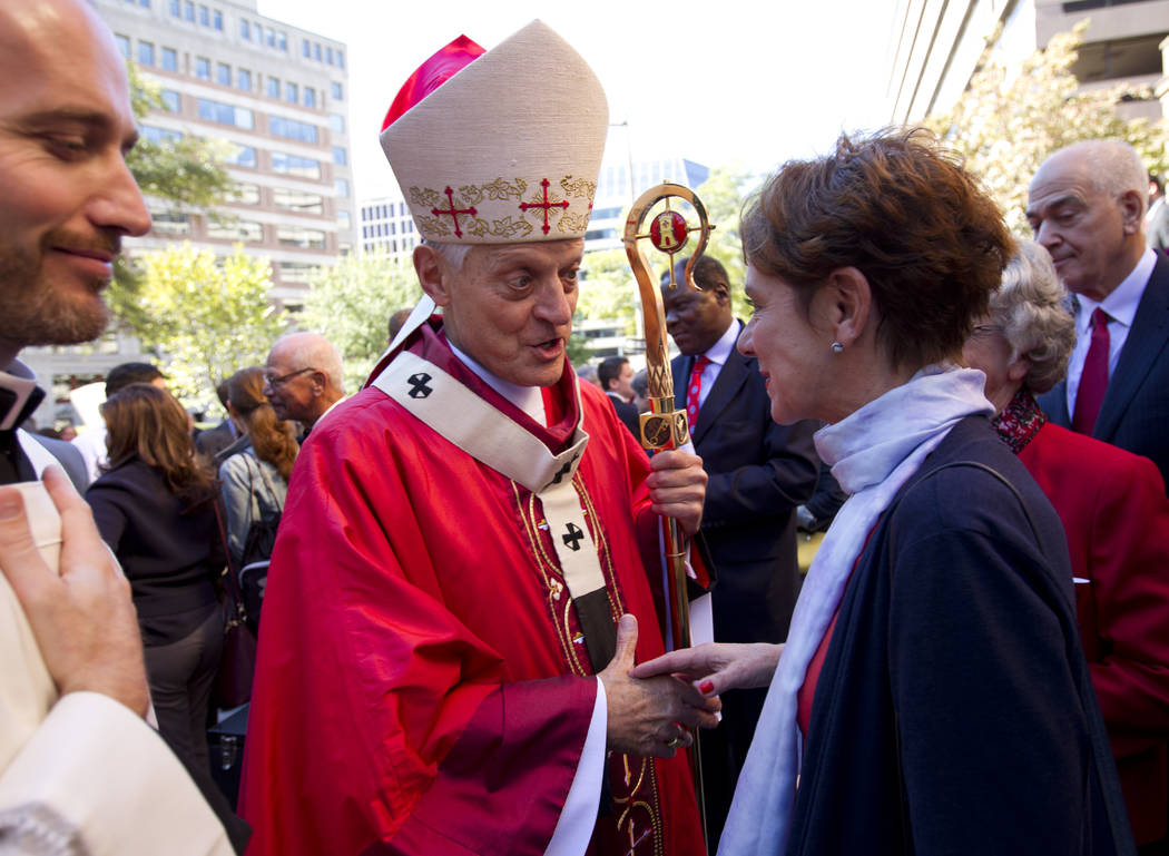Cardinal Donald Wuerl, Archbishop of Washington, shakes hands with churchgoers at St. Mathew's Cathedral after the Red Mass in Washington, Oct. 1, 2017. (Jose Luis Magana/AP, File)
