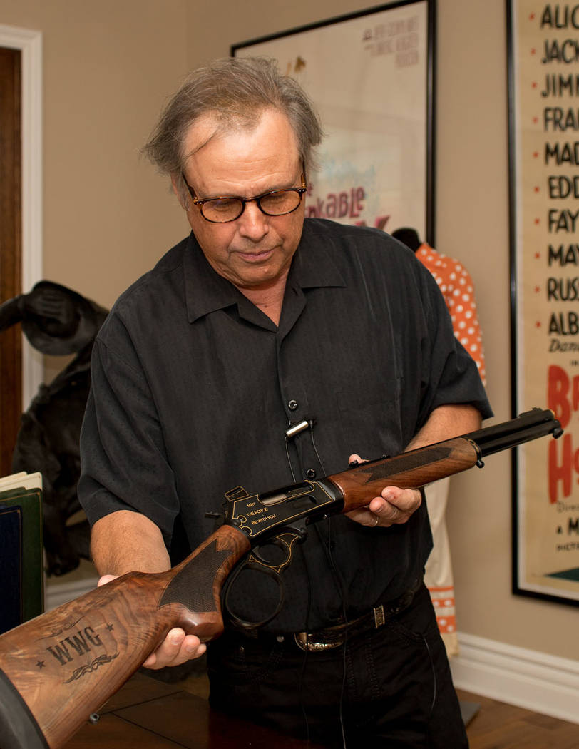 """Todd Fisher holds a gun he had made to house a """"Star Wars"""" coin given to him by his sister, Carrie Fisher. (Tonya Harvey Real Estate Millions)"""