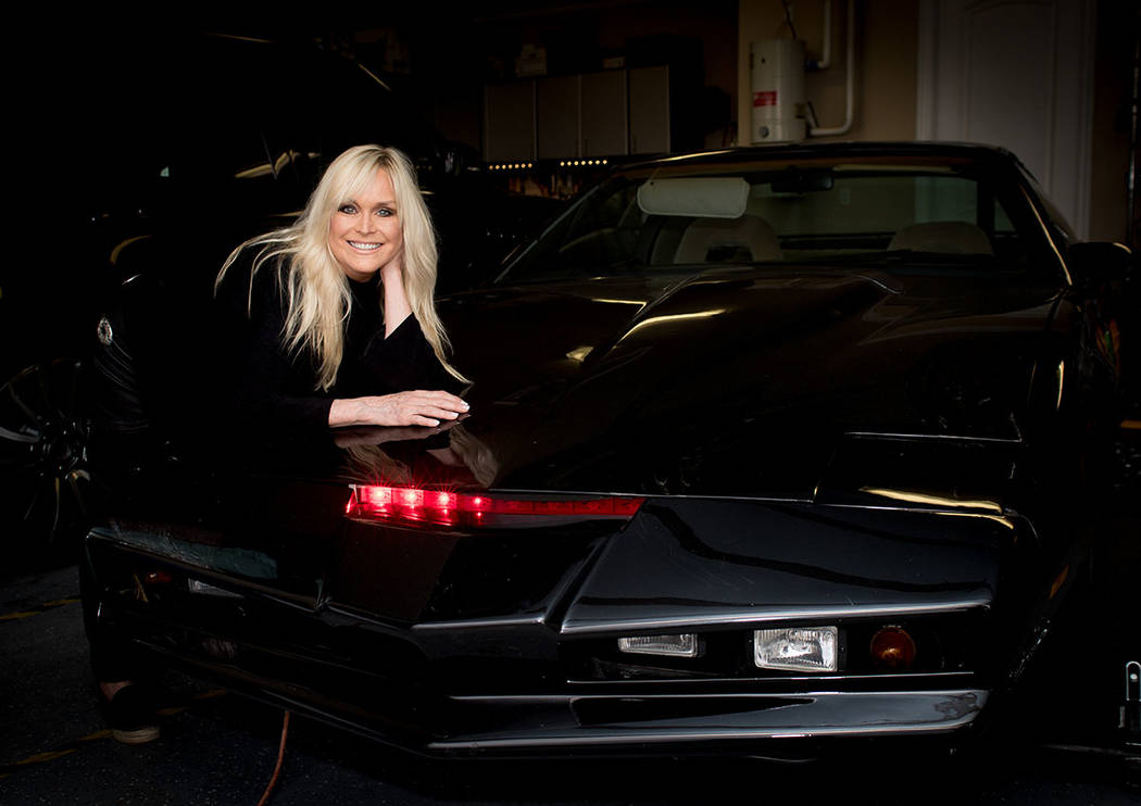 """Catherine Hickland with KITT, the talking car from """"Knight Rider."""" She had a role in the 1980s show. (Tonya Harvey Real Estate Millions)"""
