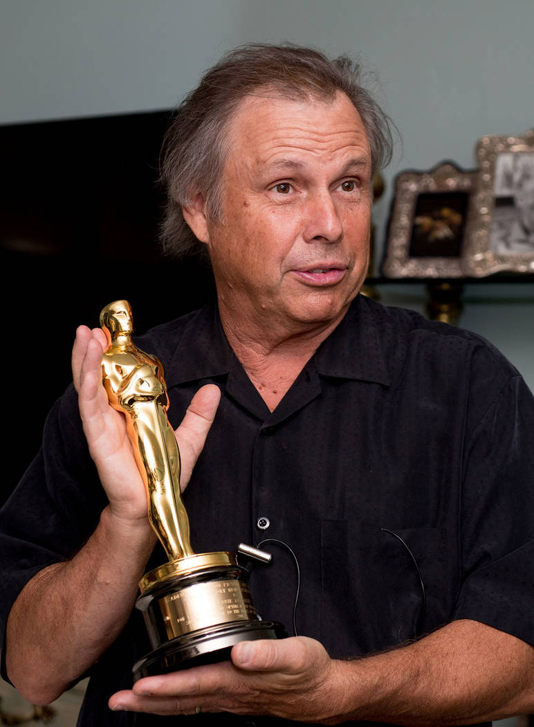 Todd Fisher holds his mother's, Debbie Reynolds, Academy Award.
