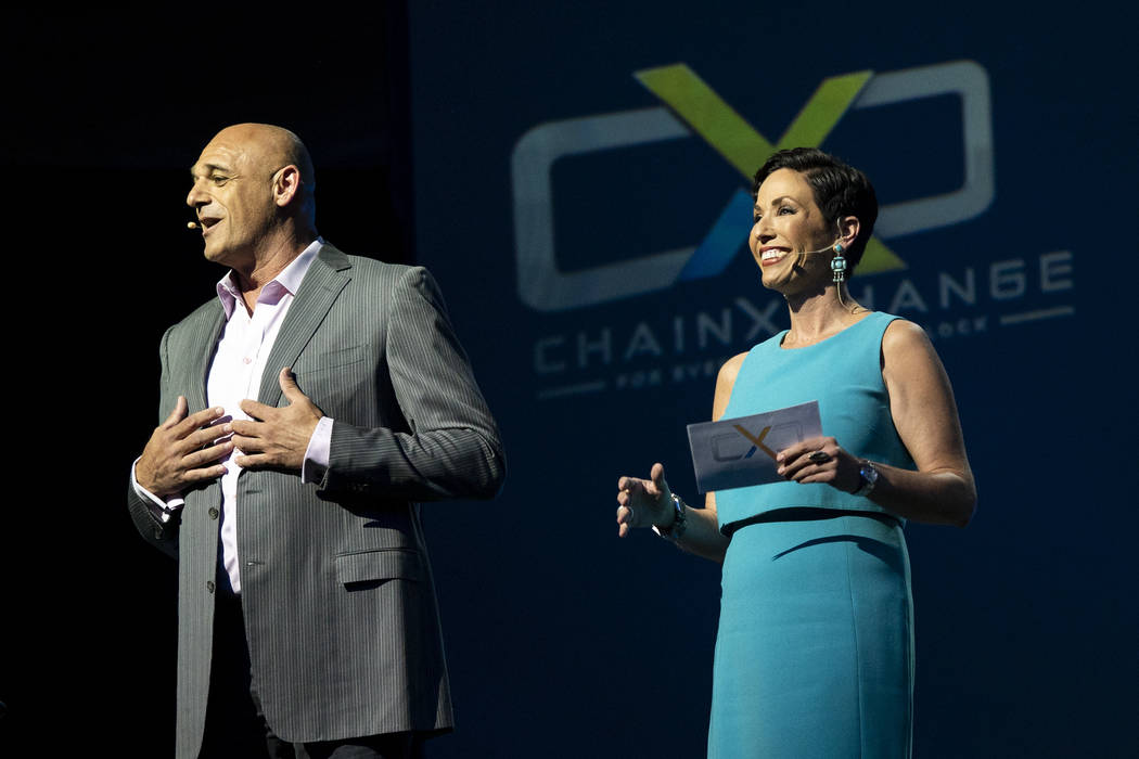 Shahi Ghanem, managing director at WI Harper Group, left, and Denise Roberson, president and CEO of Jadi Communications, introduce keynote speakers at ChainXChange at Mandalay Bay Convention Cente ...