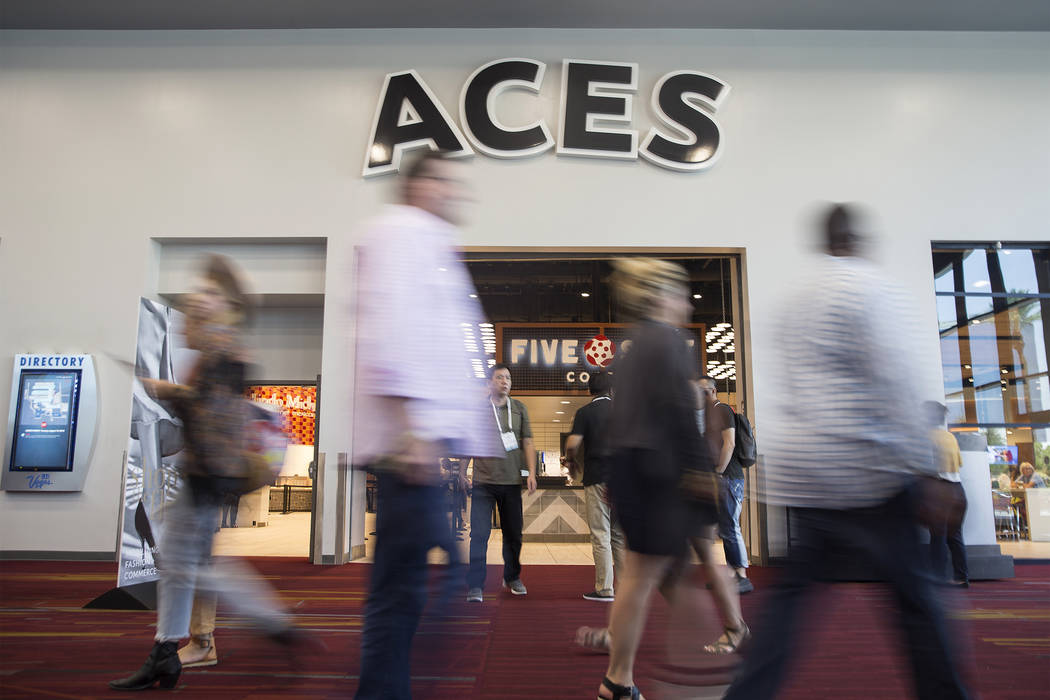 MAGIC convention attendees congregate outside Aces restaurant on Tuesday, Aug. 14, 2018, at the Las Vegas Convention Center, in Las Vegas. Benjamin Hager Las Vegas Review-Journal @benjaminhphoto