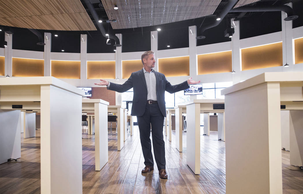 Centerplate vice president Richard Ginzel points out features of the new seating accommodations at Aces restaurant on Thursday, Aug., 9, 2018, at the Las Vegas Convention Center, in Las Vegas. Ben ...