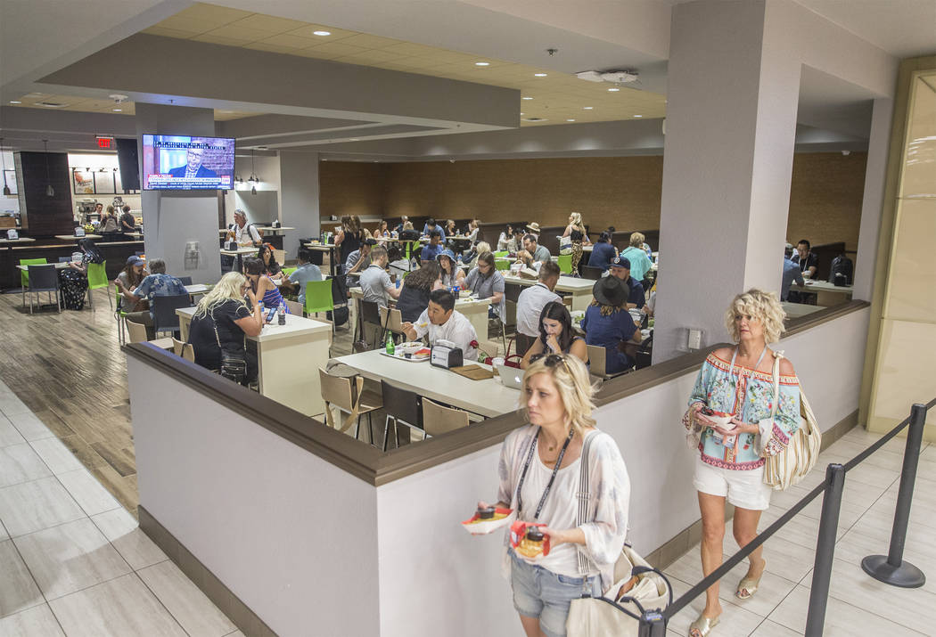 MAGIC convention attendees eat lunch at Lucky's restaurant on Tuesday, Aug. 14, 2018, at the Las Vegas Convention Center, in Las Vegas. Benjamin Hager Las Vegas Review-Journal @benjaminhphoto