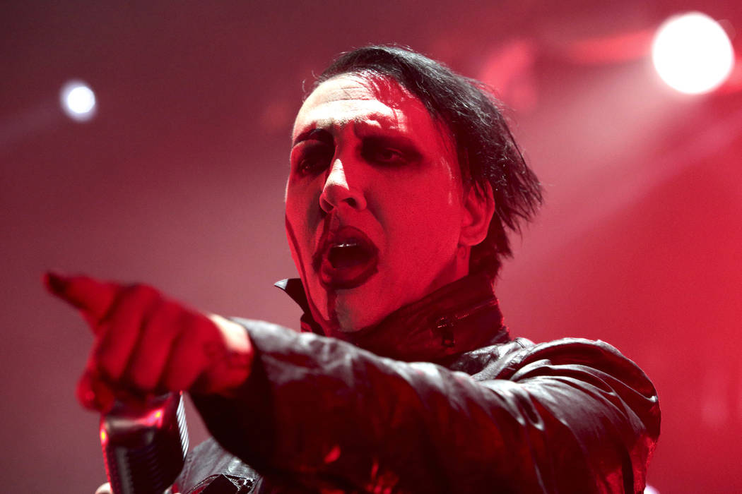 "Marilyn Manson performs in concert during the ""End Times Tour 2015"" at the Susquehanna Bank Center, in Camden, N.J. Manson's representative said Saturday, Sept. 30, 2017, that the singer was injur ..."