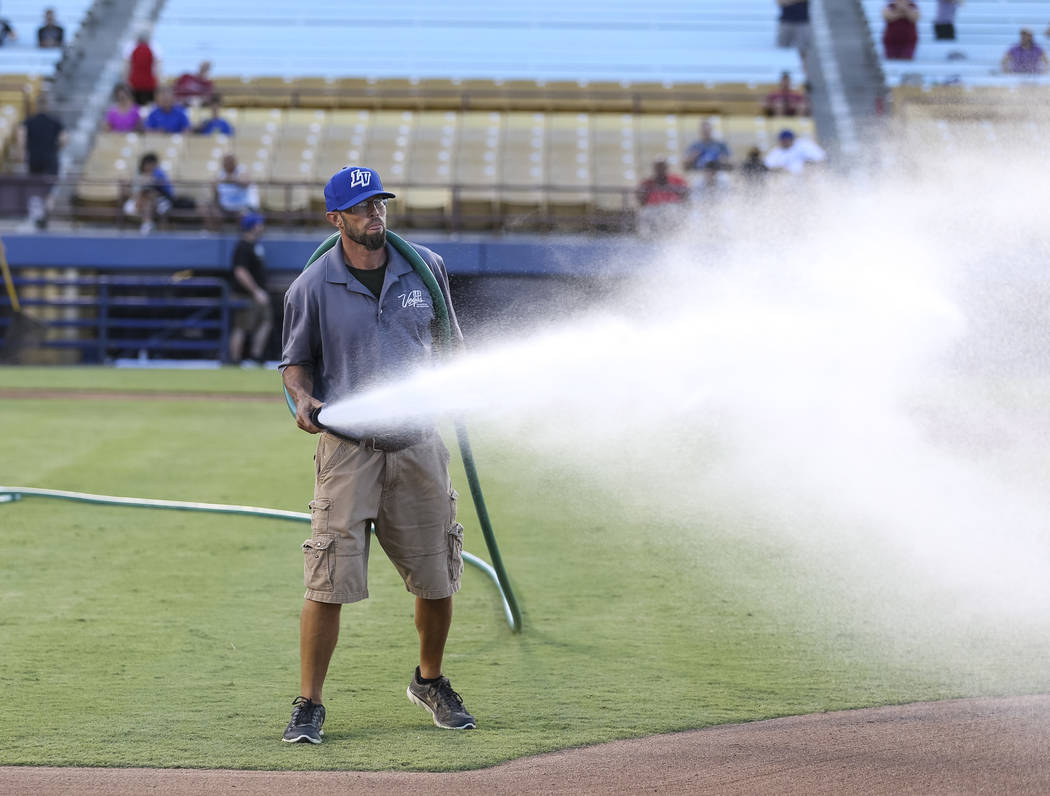 Collin Doebler, grounds manager for Cashman Field, and members of his crew prepare the infield before a Las Vegas 51s baseball game at Cashman Field in Las Vegas on Sunday, Aug. 12, 2018. Richard ...
