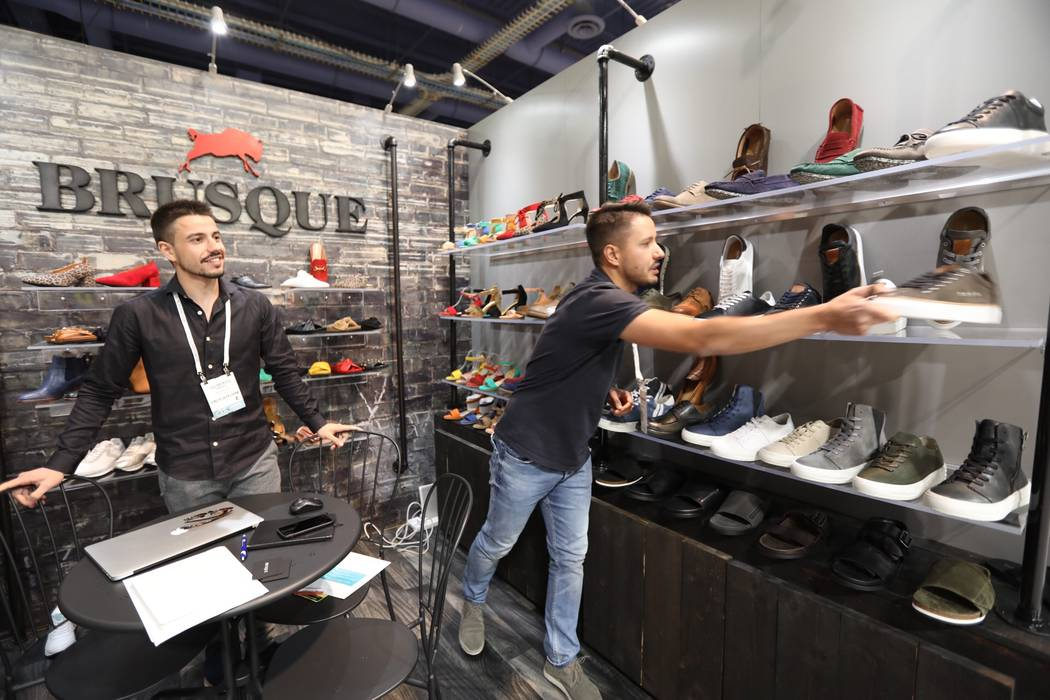 Gilberto Ribeiro and Cesar Teixeria of Brusque, a Portugese footwear maker, at the MAGIC Show at LVCC. (Todd Prince/Las Vegas Review-Journal)
