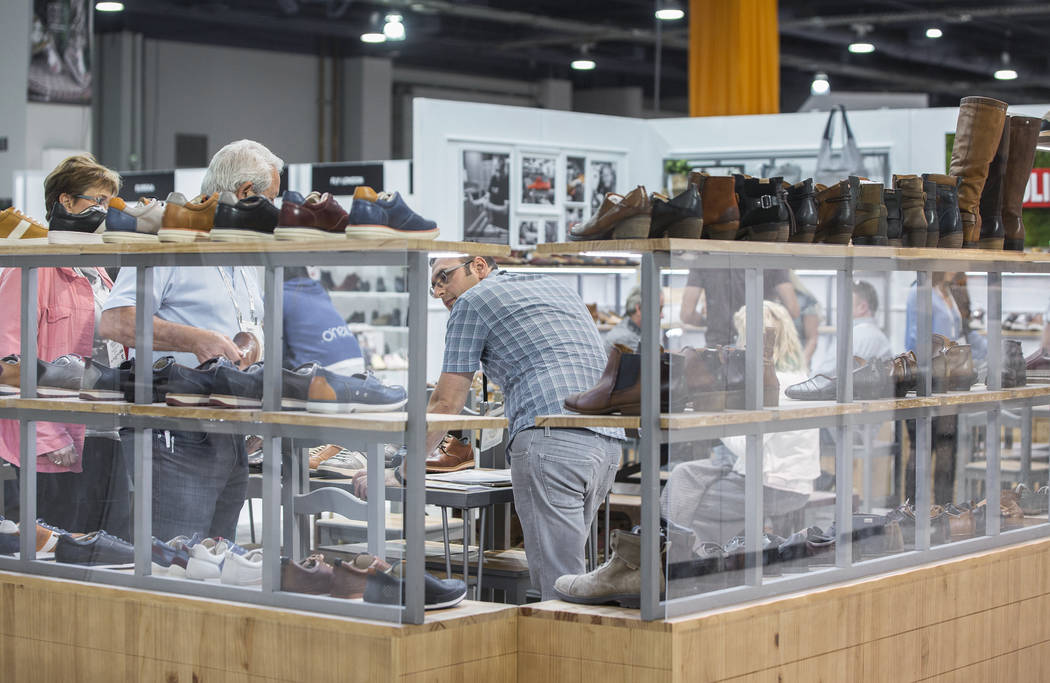Konstantin Gorshkov, a retailer with Seattle Thread Company, takes inventory during MAGIC on Wednesday, Aug. 15, 2018, at the Las Vegas Convention Center, in Las Vegas. Benjamin Hager Las Vegas Re ...