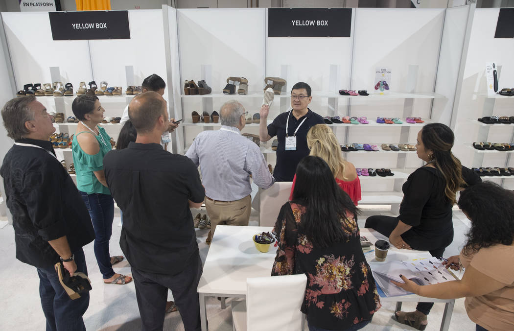 Terry Chen, top/middle, leads a team meeting at the Yellow Box booth during MAGIC on Wednesday, Aug. 15, 2018, at the Las Vegas Convention Center, in Las Vegas. Benjamin Hager Las Vegas Review-Jou ...