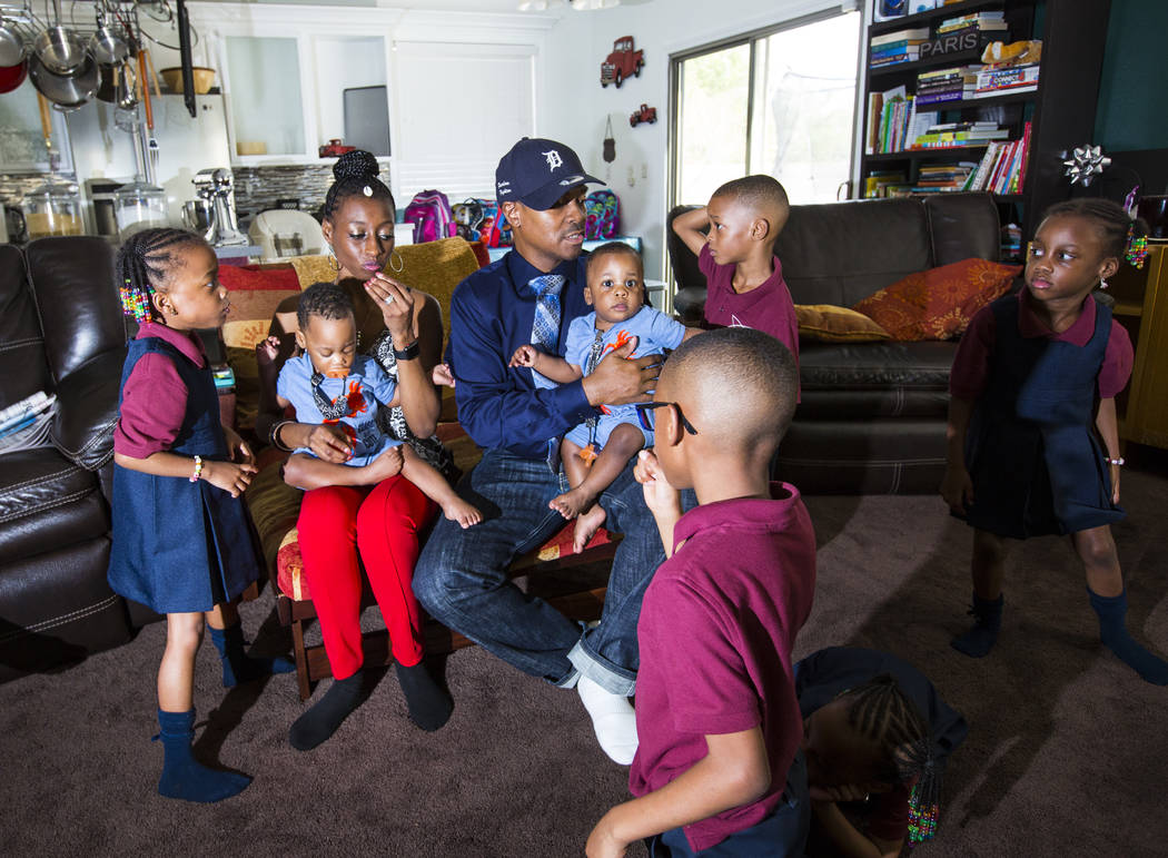 Deon Derrico, center, with wife, Karen Evonne Derrico, and some of their 11 children before posing for a family photo at their home in North Las Vegas on Wednesday, Aug. 15, 2018. Chase Stevens La ...