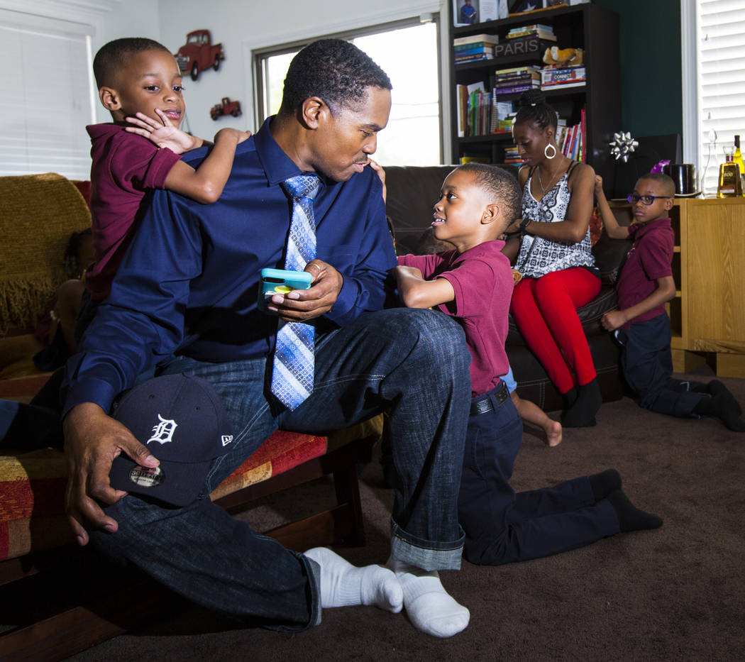 Deon Derrico sits with his children, Deniko, 4, left, and Denver, 6, at their home in North Las Vegas on Wednesday, Aug. 15, 2018. Chase Stevens Las Vegas Review-Journal @csstevensphoto