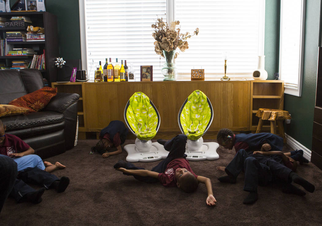 Some of the 11 Derrico children relax at home in North Las Vegas on Wednesday, Aug. 15, 2018. Chase Stevens Las Vegas Review-Journal @csstevensphoto