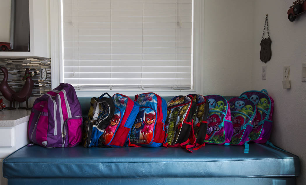 Backpacks belonging to the children of Deon Derrico at their home in North Las Vegas on Wednesday, Aug. 15, 2018. Chase Stevens Las Vegas Review-Journal @csstevensphoto