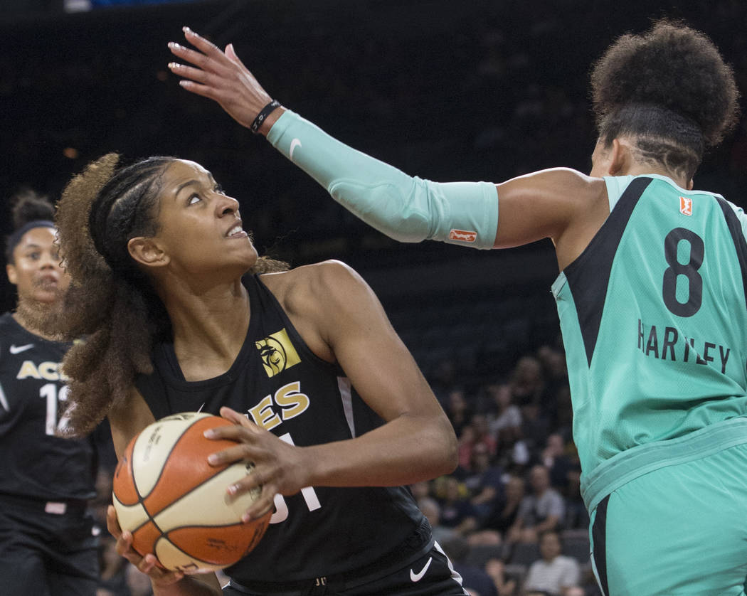 Aces guard Jaime Nared (31) drives past New York Liberty guard Bria Hartley (8) in the second quarter on Wednesday, Aug. 15, 2018, at the Mandalay Bay Events Center, in Las Vegas. Benjamin Hager L ...