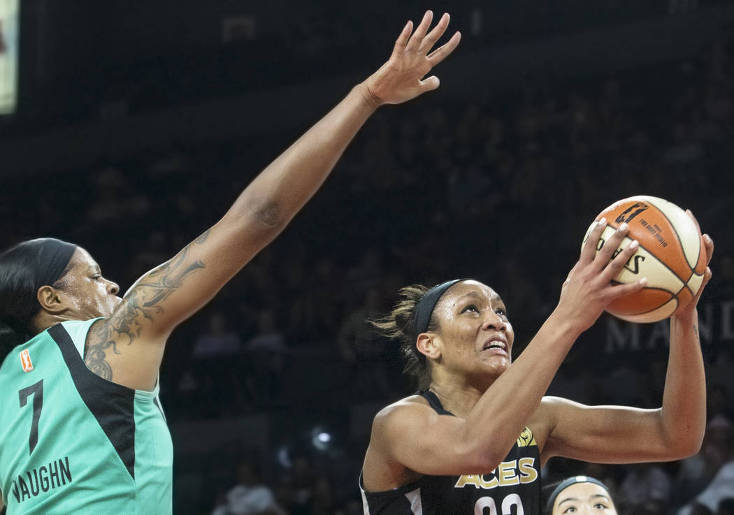 Aces center A'ja Wilson (22) drives past New York Liberty center Kia Vaughn (7) in the first quarter on Wednesday, Aug. 15, 2018, at the Mandalay Bay Events Center, in Las Vegas. Benjamin Hager La ...