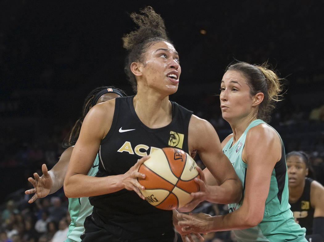 Aces forward Dearica Hamby (5) drives past New York Liberty guard Rebecca Allen (9) in the second quarter on Wednesday, Aug. 15, 2018, at the Mandalay Bay Events Center, in Las Vegas. Benjamin H ...