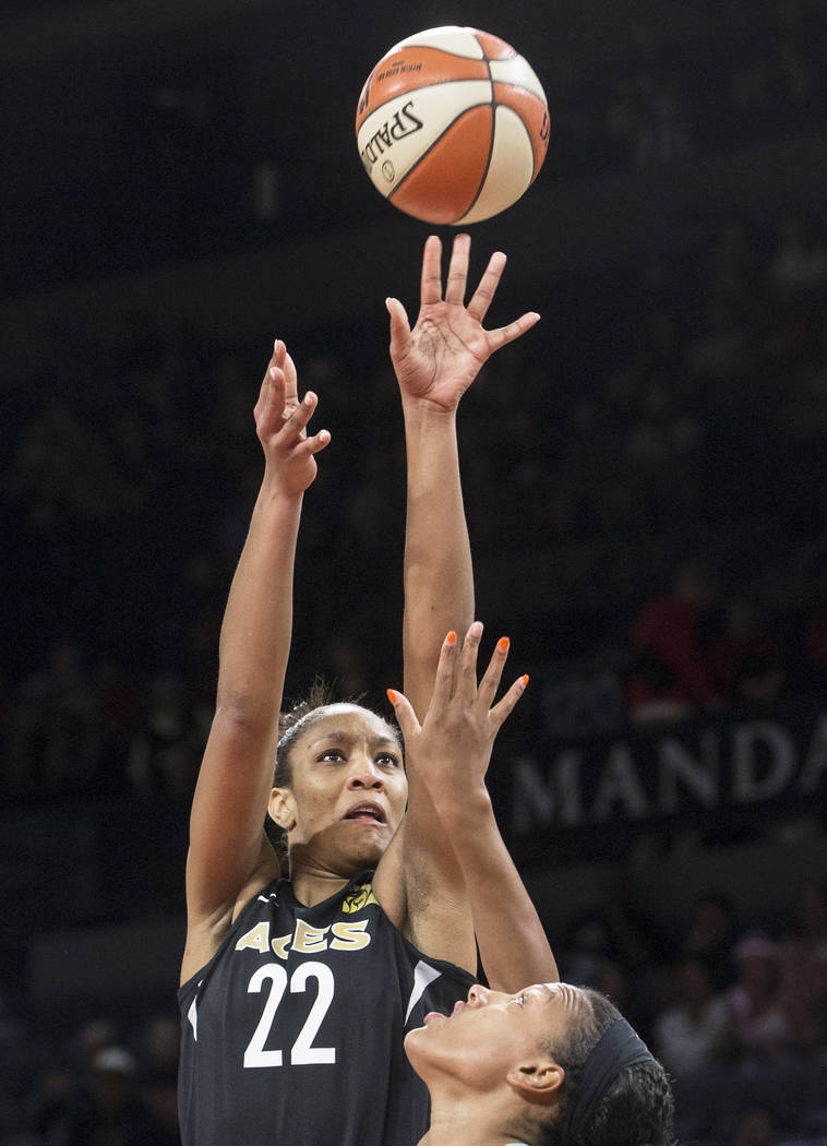 Aces center A'ja Wilson (22) shoots over New York Liberty guard Kiah Stokes (41) in the first quarter on Wednesday, Aug. 15, 2018, at the Mandalay Bay Events Center, in Las Vegas. Benjamin Hager L ...