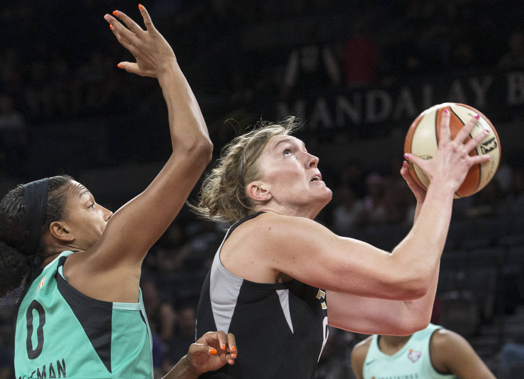 Aces center Carolyn Swords (8) drives past New York Liberty guard Marissa Coleman (0) in the first quarter on Wednesday, Aug. 15, 2018, at the Mandalay Bay Events Center, in Las Vegas. Benjamin ...