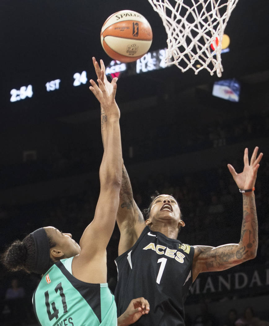 Aces forward Tamera Young (1) fights for a rebound with New York Liberty guard Kiah Stokes (41) in the first quarter on Wednesday, Aug. 15, 2018, at the Mandalay Bay Events Center, in Las Vegas. B ...