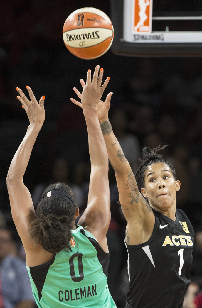 Aces forward Tamera Young (1) reaches out to contest the shot of New York Liberty guard Marissa Coleman (0) in the fourth quarter on Wednesday, Aug. 15, 2018, at the Mandalay Bay Events Center, in ...