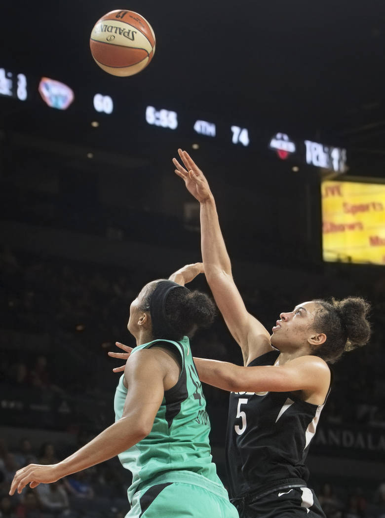 Aces forward Dearica Hamby (5) shoots over New York Liberty guard Kiah Stokes (41) in the fourth quarter on Wednesday, Aug. 15, 2018, at the Mandalay Bay Events Center, in Las Vegas. Benjamin Hage ...