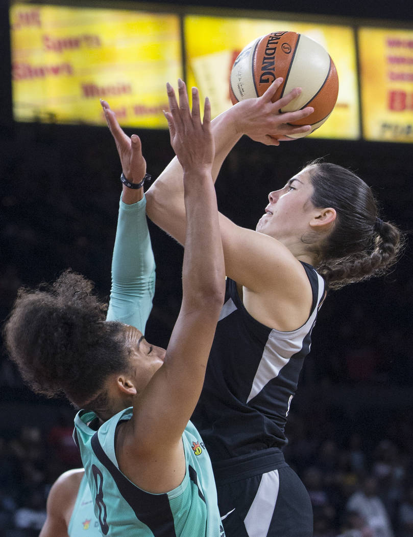 Aces guard Kelsey Plum (10) shoots over New York Liberty guard Bria Hartley (8) in the fourth quarter on Wednesday, Aug. 15, 2018, at the Mandalay Bay Events Center, in Las Vegas. Benjamin Hager L ...