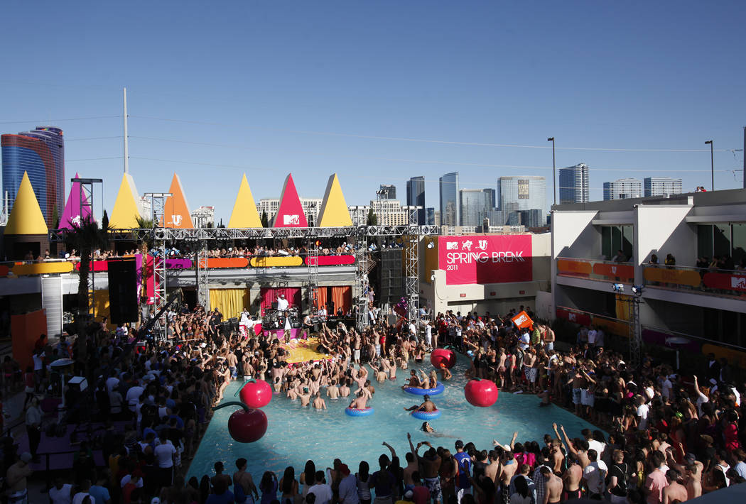 Thousands take in a live performance by Lupe Fiasco during filming for a MTV's Spring Break 2011 episode at the pool in the Palms hotel-casino on Tuesday, Mar. 8, 2011. RJ FILE*** JESSICA EBEL ...