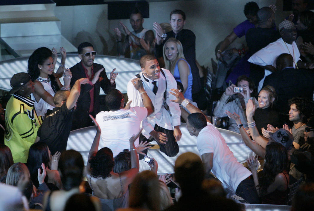 Musician Chris Brown, center, performs at the MTV Video Music Awards at the Palms Hotel and Casino on Sunday, Sept. 9, 2007, in Las Vegas. (AP Photo/Mark J. Terrill)
