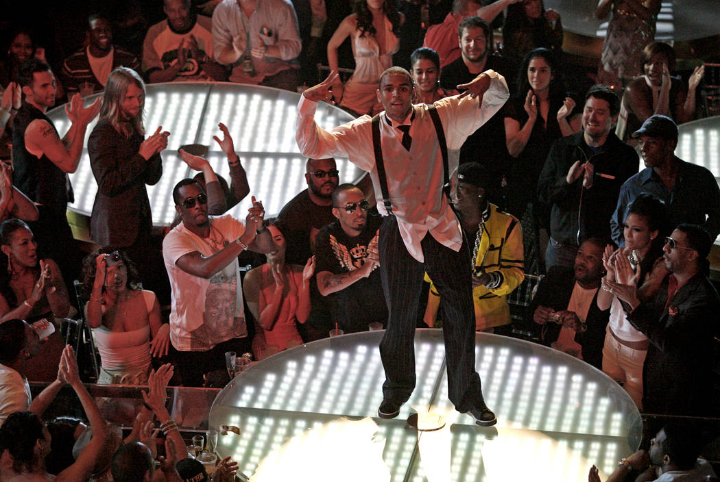 Chris Brown performs at the MTV Video Music Awards at the Palms Hotel and Casino on Sunday, Sept. 9, 2007, in Las Vegas. (AP Photo/Eric Jamison)