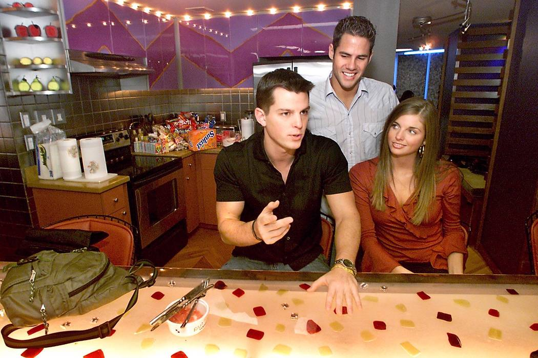 Shown in the kitchen of the penthouse suite, MTV's Real World Las Vegas cast members from left, Frank, 22, Steven, 24, and Trishelle, 22, (no last names per the show's policy) talk about their exp ...