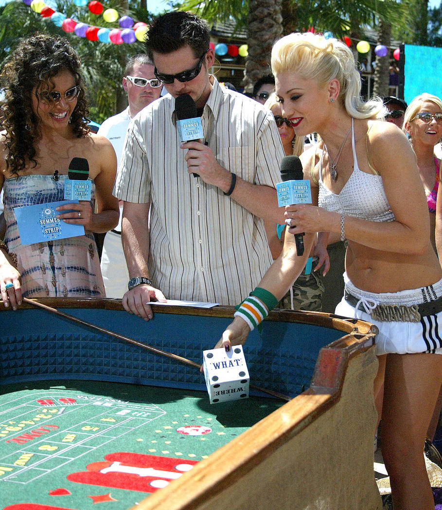 MTV VJ's Vanessa Minnillo and Damien Fahey ask Gwen Stefani questions as she rolls the dice at the Hard Rock Hotel and Casino in Las Vegas, Monday, May 30, 2005 as part of the MTV Summer on the St ...