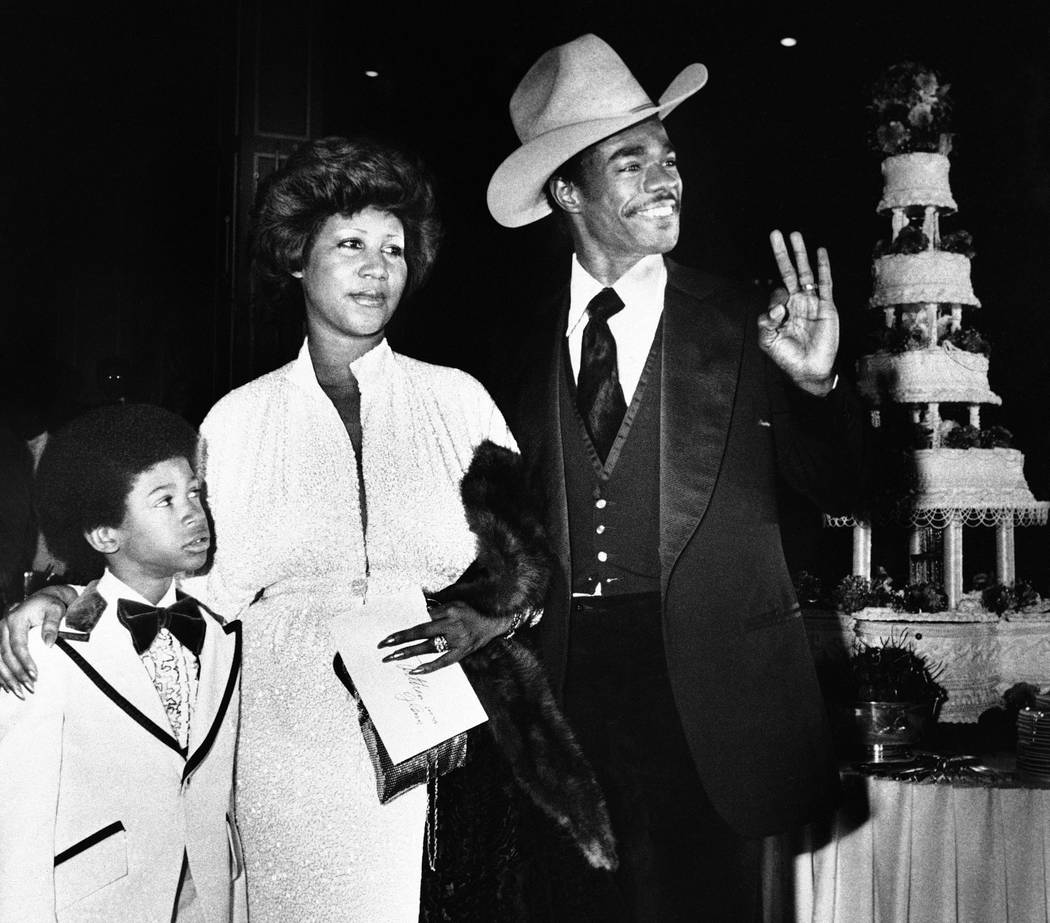 Aretha Franklin and her new husband, Glen Turman, arrive at a Los Angeles hotel for their wedding reception, April 17, 1978. Turman signals his OK and pleasure at the reception as Kecalf, 8, Areth ...